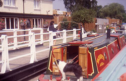 Lady and her dog going through a lock